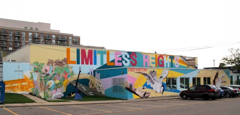 Colourful large mural reading Limitless Heights