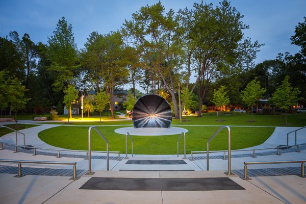 A bandshell illuminated from the centre.