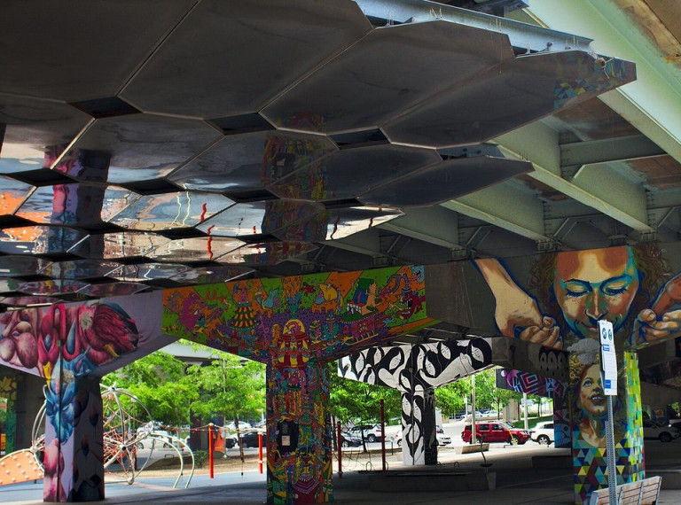 Murals at Underpass Park by multiple artist in different styles.