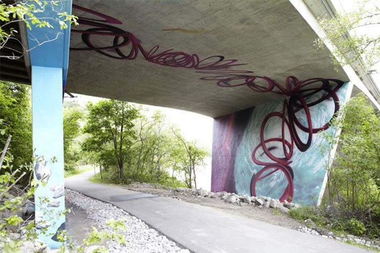 Mural under a bridge of abstract winding shapes