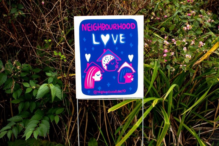 Image of a small lawn sign reading Neighbourhood Love