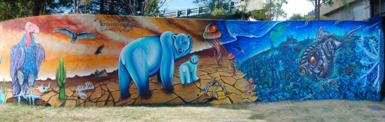 Large mural featuring animals in an orange and blue colour pallet