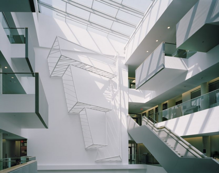 Installation in a three story white building