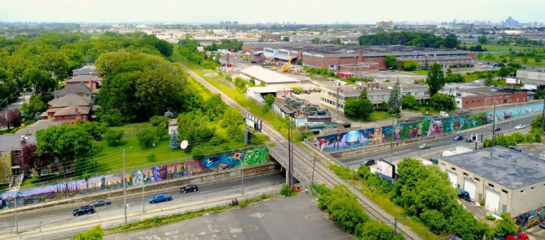 Arial shot of a long mural across a T intersection