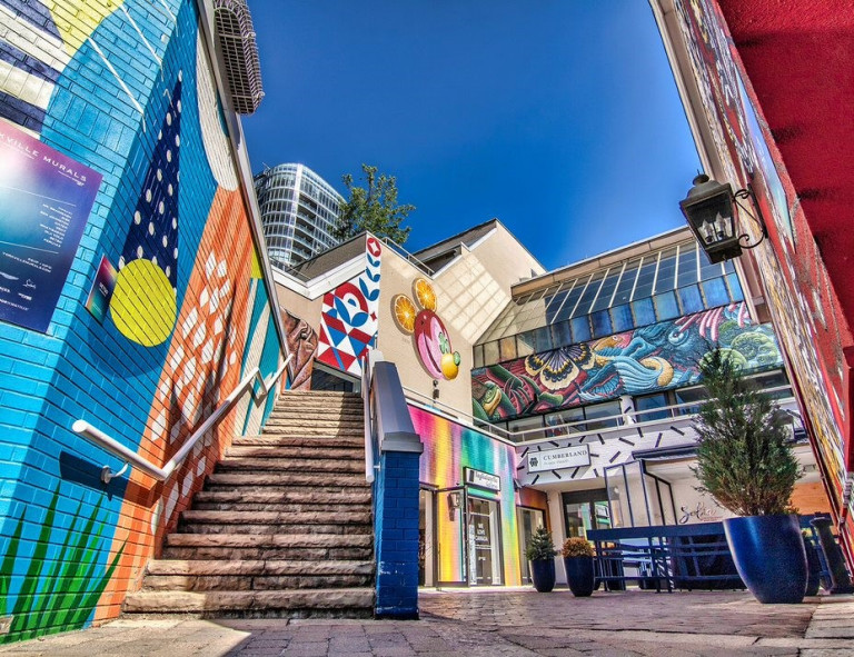 Colourful murals in a courtyard at 99 Yorkville Ave