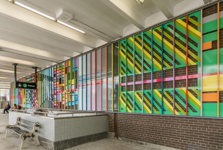 Colourful mural comprised of lines, located in a TTC station