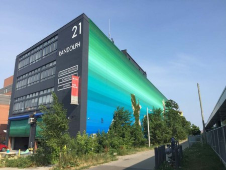 Image of a large mural of a colour gradation from sky blue to green